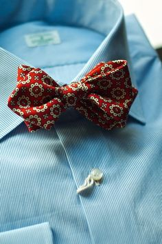 White shirt with blue dress stripes, red batwing bow tie