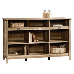 If you like to keep things neat and tidy you will appreciate this storage credenza. With cubbyhole storage and the ability to accommodate label tags, this piece of storage furniture will straighten up any room.Cubbyhole storage.Accommodates ID label tags.Three adjustable shelves.Craftsman Oak finish.