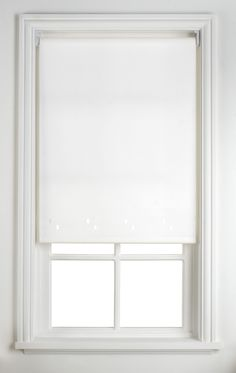 Transform a boring window roller blind by covering it with pretty fabric and attaching it with hot glue.