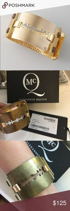 """McQ Alexander McQueen Leather Razor Cuff Bracelet McQ Alexander McQueen Leather Razor Cuff Bracelet Large, Gold Shiny leather. Golden, brassy razor blade-inspired center. Approximately 7 1/2""""L x 1 1/2"""" at widest. Push-through grommet closure. Alexander McQueen Jewelry Bracelets"""