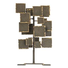 The Ivan Sculpture from Arteriors Home adds an artful layer to a cocktail or console table. Hammered natural iron panels in varied sizes are layered atop one an
