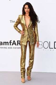 Shanina Shaik shines in a gold suit in Cannes.