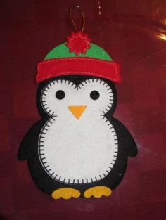 penguin felt ornament Pic onlyLarge Flat Stiff Felt Penguin in hat Holiday by emmadreamstarpenguin felt ornament--use construction paper--fleece for hat w/puffPenguin Feltie - not available but a cute idea for a Quiet Book or ornamentUnavailable List Felt Christmas Decorations, Felt Christmas Ornaments, Noel Christmas, Handmade Christmas, Penguin Ornaments, Christmas Nativity, Christmas Projects, Felt Crafts, Holiday Crafts