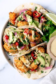 These roasted cauliflower tacos are seriously the best. Roast cauliflower with lots of spice and add homemade cilantro lime tahini sauce, avocado, pickled red onions, and fresh herbs. Veggie Recipes, Salad Recipes, Vegetarian Recipes, Cooking Recipes, Healthy Recipes, Cauliflower Tacos, Roasted Cauliflower Salad, Clean Eating, Healthy Eating