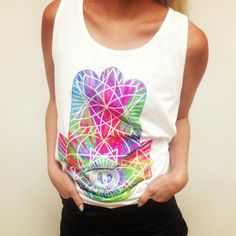 "Feeling psychedelic in this ""iamvibes"" tank! Get it in the #NYLONshop here: www.shop.nylonmag.com/products/tie-dye-geometric-vest"