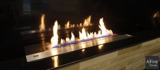 A smart design, ease of use and electronic safety measures are the advantages of ethanol burners with remote control by AFIRE Bioethanol Fireplace, Conduit, Fireplace Inserts, Hearth, Voordelen Van, Remote, Building, Smart Design, Ethanol Fireplace