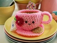 tea cups, cups and crochet.