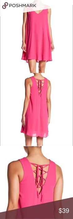 """Chelsea28 Pink Lace Up Back Dress Chelsea28 Pink Lace Up Back Dress A lace-up back adds a breezy finishing touch to a flowy, carefree slipdress. - V-neck - Sleeveless - V-back with lace-up detail - Lined - Approx. 35"""" length  - 100% rayon Nordstrom Dresses Mini"""