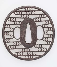 Tsuba with design of stylized waves. Japanese. Edo period. mid-late 17th century. Akao School