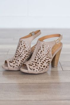 """Cutout detail slingback heels with a chunky stacked heel. Man made material. Heel measures 4"""""""" tall. Fits true to size. Style #SBAILEY-57TAUPE"""