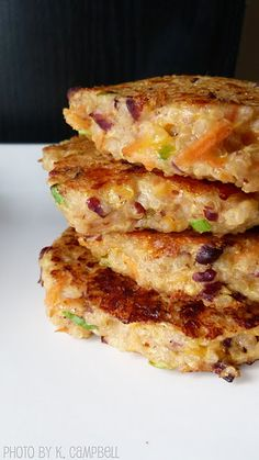 Quinoa Burgers: Ingredients: Cooked quinoa Black beans Shredded cheese 1 Tbl cream cheese 2 eggs Chopped white onion Shredded carrots 2 cloves garlic, minced Hot sauce 2 Tbl flour 1 Tbl flax seed Salt Chili powder Black pepper === Instructions: Cook quinoa. Let cool Chop vegetables and set aside Smash beans into a paste. Mix vegetables, beans,eggs, cream cheese, cheese, flour, flax seed, hot sauces and spices. Stir all of the ingredients. Heat oil in a large pan. form patties. fry 3-4min ea…