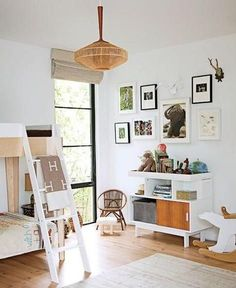 Floor to ceiling black frame windows and Oeuf perch bunk bed for kids