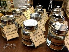 Great Favors! Buy empty jars, twine, and labels from a craft store. Print your own tags and seals. Fill with real moonshine!
