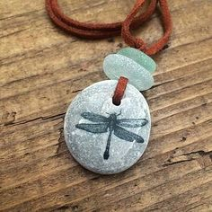 Rustic Sea Glass and Beach Stone Dragonfly Necklace. Dragonfly Necklace, Sea Glass Necklace, Beach Stones, Grey Stone, Leather Necklace, Sea Foam, Unique Gifts, Finding Yourself, Etsy Shop
