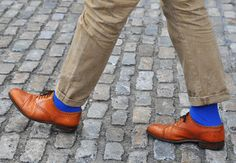 The shoes here are great but the contrast of the striking cobalt blue socks take the whole look a step further