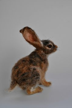 Needle felted animal. Cottontail Rabbit Felted soft sculpture.Wool Felt Animals. by darialvovsky on Etsy https://www.etsy.com/listing/225612000/needle-felted-animal-cottontail-rabbit