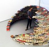Breathtaking igloo designed by Miler Lagos.   http://inhabitat.com/miler-lagos-awesome-igloo-is-stacked-high-with-hundreds-of-recycled-books/miler-lagos-book-igloo/?extend=1
