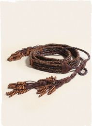 The intriguing pima belt is handcrafted with beaded tassel ties.