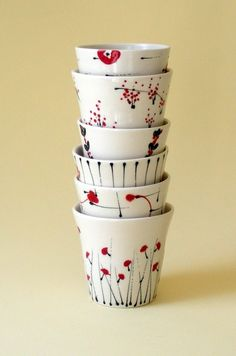 Porcelain cups. I love the red and black decoration on these.  By Kristen Swanson.