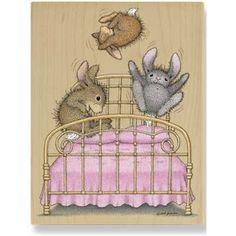 Three little bunnies jumpin on the bed..