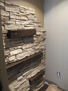 Bathroom wall with shelving