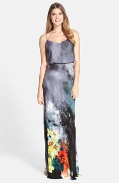 A soft, flattering blouson waistline shapes an intriguing chiffon maxi dress that's printed with dark, stormy watercolors and pops of bright flowers at the hem.