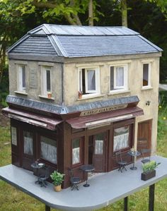Chez Gavroche by Livia Herman - Not sure if this is a dollhouse or a bird feeder?? Cute