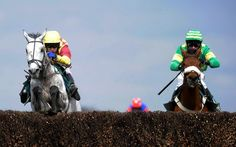 LIVERPOOL, ENGLAND - APRIL 05: Tom Scudamore riding Dynaste (L) clear the last to win the John Smith's Mildmay Novices' Steeple Chase at Aintree racecourse on April 05, 2013 in Liverpool, England. (Photo by Alan Crowhurst/Getty Images)