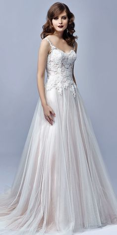 Beautiful by #Enzoani style BT17-03 is a true fairytale wedding dress! This classic A-line gown features a flowing, soft tulle skirt and the most strikingly romantic embroidered lace bodice with a delicate scalloped sweetheart neckline. #Enzoani