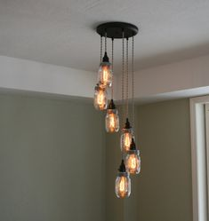 Beautiful 6Strand Jar Chandelier on 10 Oil Rubbed Bronze Ceiling mount, all wired with your choice cord color/style. Sockets are UL Listed