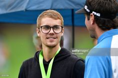 Musician Justin Bieber looks on with Bubba Watson of the United States during a practice round prior to the 2017 PGA Championship at Quail Hollow Club on August 8, 2017 in Charlotte, North Carolina.