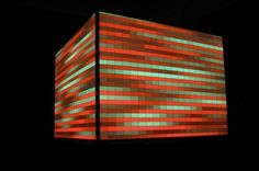 Sonik cube — Sonik Cube is an enormous lamp measuring 3 by 3m, which reacts to sound. On the faces of the Cube, the visual display reacts to sound captured by microphones and can be bent, marked, dented or distorted through the interactions of the visitor. — trafik.fr