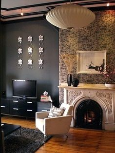 For master bedroom's unpaintable walls: hang fabric, centered between solid temporary wallpaper