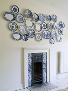 blue and white...I have my plate collection hanging on the wall just like this...makes me smile every single day. Wish the good fairy would come & wash them all!! LOL...