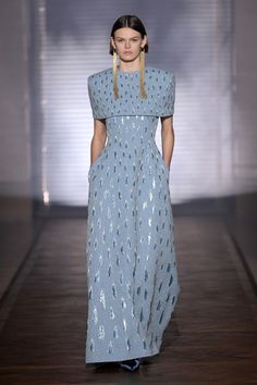 Squared shoulder powder blue capelet dress with metallic gold embroidered medallions - Givenchy Couture Spring 2018 Paris Fashion Week
