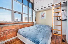 Feather Factory Lofts-2154 Dundas St W #PH1 | WOW! Rare penthouse junior 1 bedroom authentic post, brick & beam heritage LOFT, with exposed brick walls, extra high 14.5 ft high factory wood ceilings & bright West exposure from large warehouse windows. | More info here: torontolofts.ca/feather-factory-lofts-lofts-for-sale/2154-dundas-st-w-ph1-1 Exposed Brick Walls, Wood Ceilings, Murphy Bed, Lofts, Beams, Warehouse, Shelving, Feather, Bright
