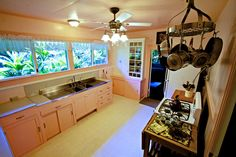 I just love this kitchen in a 1941 four-bedroom house (and adjoining guest cottage) in Kealakekua, a small residential community in the Kona Coffee Belt of Hawaii's Big Island, about a mile inland from the island's western shore.  It would really just be appropriate for a house in a tropical area, but I think it's really neat.