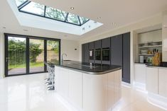 Kitchen extension framed with Bi-folding Doors Modern Kitchen Cabinets, Kitchen Cabinet Design, Modern Kitchen Design, House Extension Design, Extension Ideas, House Design, Kitchen Extensions, House Extensions, Bi Folding Doors Kitchen