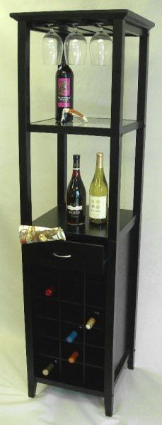 """Galina Wine Tower - Holds 18 Bottles (Matte Black) (66""""H x 17""""W x 17""""D). Impress your guests with a well stocked wine bar! This wine tower holds 18 bottles of your favorite wines and 9 wine glasses on a built-in stemware rack. With a drawer for towels, corkscrews and other accessories, and two shelves for additional bar items and mixers, this wine rack has everything you need to entertain friends! The tall, narrow design saves valuable floor space. Made of wood with a matte black finish…"""