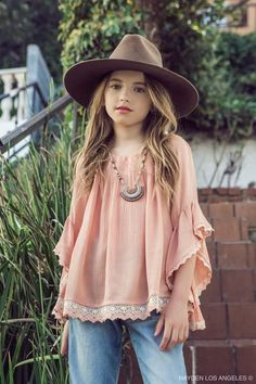 Soft and flowy apricot tunic can be worn on or off the shoulders.