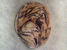 Wall plaque, earthenware clay.