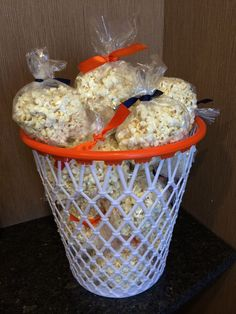 Basketball themed party | Creative basketball party food display: bags of popcorn in basketball net trash can. Ideal for a basketball themed bar mitzvah!