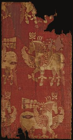 A SILK SAMIT TEXTILE FRAGMENT, NEAR EAST (?), 12TH CENTURY OR EARLIER the fragment woven with red and cream silk threads with horizontal registers of winged horses in convoy 50.5 by 26cm.