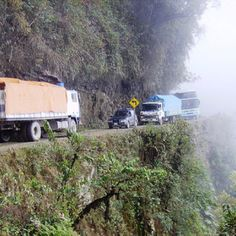 """The North Yungas Road is a 43 mile road connecting La Paz and Coroico deep into the Bolivian Andes. The road is name by the locals """"El Camino de la Muerte"""" or the Road of Death and it was named the world's most dangerous road in Shimane, Yungas Bolivia, Yungas Road, Places Around The World, Around The Worlds, Tottori, The Road Not Taken, Dangerous Roads, Beautiful Roads"""