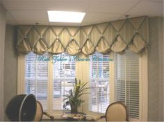 Diamond shaped cornice (button tufted) with shallow swag peeking from under each reverse point of diamond