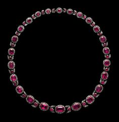 The necklace consists of twenty three oval clusters, each set with a ruby surrounded by rose diamonds, graduated in size from the centre towards the ends, and alternating with stylised flower buds, each set with a ruby between rose diamonds. The clasp at the back is concealed by a cluster each setting is closed at the back. 2nd half of the 18th century.