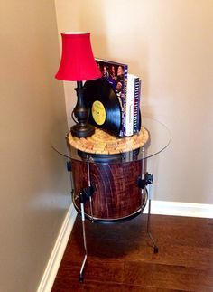 Beautiful wood grain on the drum with a wine cork top and glass for a rockin' cool side table.  Looking for more music conversation pieces go to www.musicasartbysarah.etsy.com