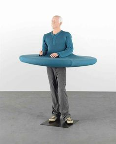 """Erwin Wurm [Austria] (b 1954) ~ """"The artist who swallowed the world when it was still a disc"""", 2006. acrylic, synthetic resin, woo; jumper, trousers and shoes (190 x 137 x 137 cm).   #art #sculpture #figurative #conceptual_art #installation"""