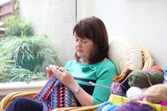 Woman with depression crocheting - Miss Pearl/ Moment/ Getty Images