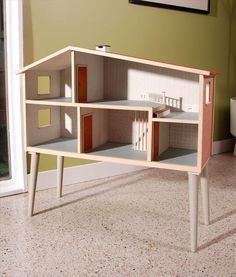 Retro-style, mid-century modern dollhouse, origin and purpose unknown. Barbie *wishes* her dream house looked this awesome.